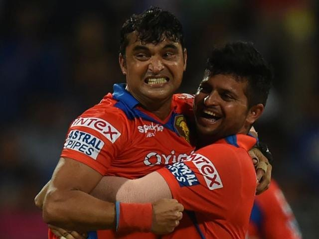 Gujarat Lions captain Suresh Raina (R) and Pravin Tambe celebrate a wicket.
