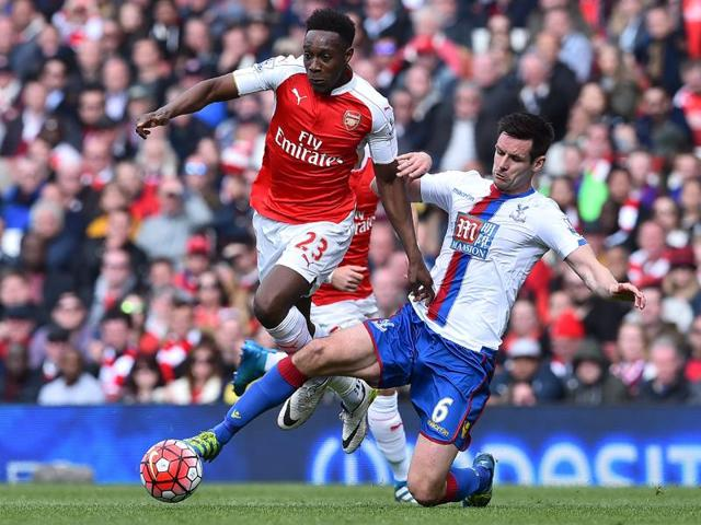 Crystal Palace's Joe Ledley in action with Arsenal's Nacho Monreal.
