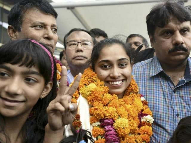 Dipa Karmakar leaves IGI airport in New Delhi after returning to India following her qualification for the Rio Olympics.