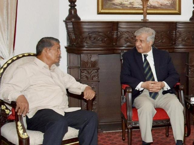 Uttarakhand chief minister Harish Rawat meets Governor KK Paul in Dehradun on Thursday after the Uttarakhand High Court quashed the imposition of President' rule in the state.