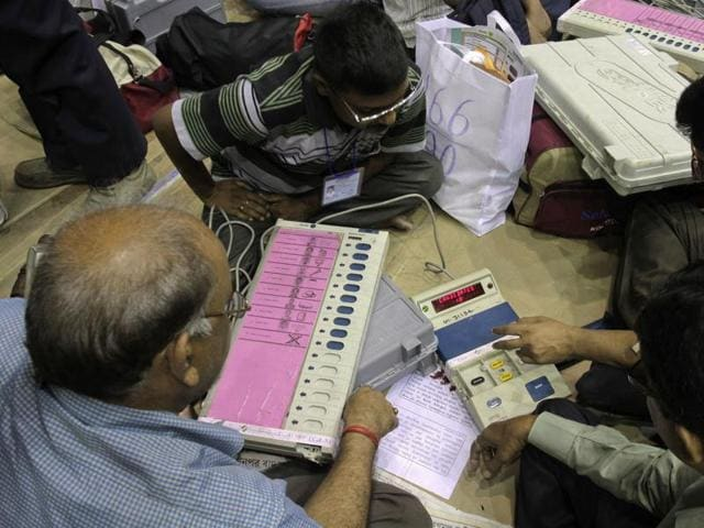 Election officials inspect electronic voting machines and other polling material  ahead of the third phase of voting to the West Bengal state Assembly elections in Kolkata,  Wednesday, April 20, 2016.
