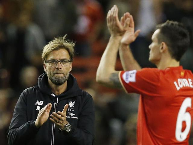Juergen Klopp with James Milner as he is substituted against Eveton in the Premier League.
