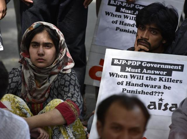 Activists of the Muslim Khawateen Markaz protest the killing of four people at Handwara earlier this week.