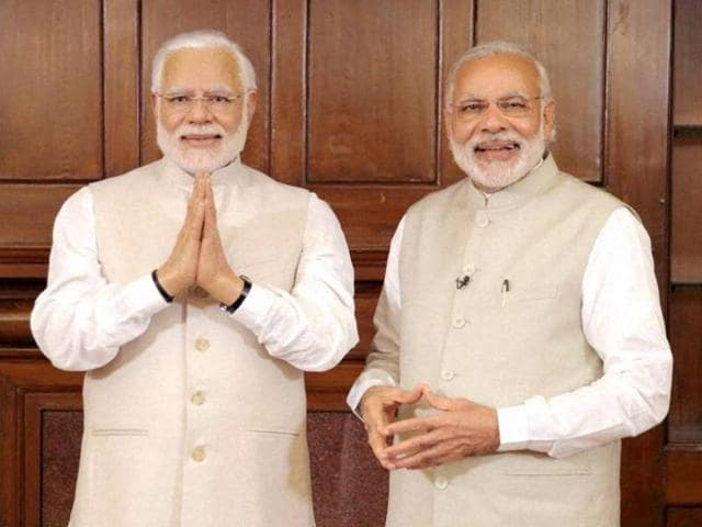 Prime Minster Narendra Modi with his wax statue due to be placed at London's Madame Tussauds museum next week. Modi had a private viewing of the statue earlier this week.