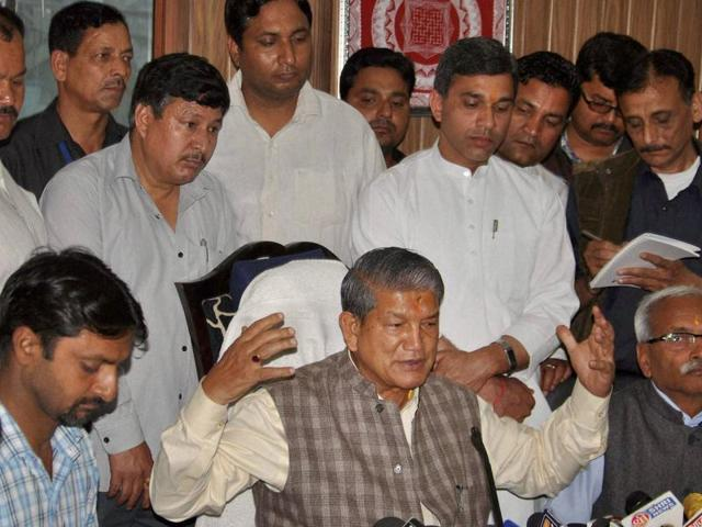 Former Uttrakhand chief minister Harish Rawat addresses a press conference in Dehradun.