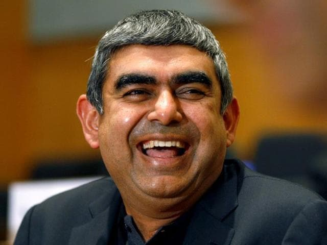 CEO and MD of Infosys Vishal Sikka smiles during a press conference at the company's headquarters in Bangalore.