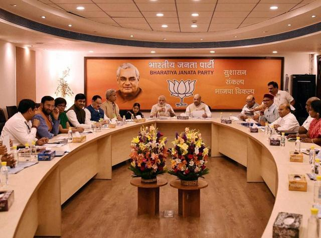 Prime Minister Narendra Modi , BJP president Amit Shah, home minister Rajnath Singh and others at BJP's election committee meeting onTamil Nadu, in New Delhi.