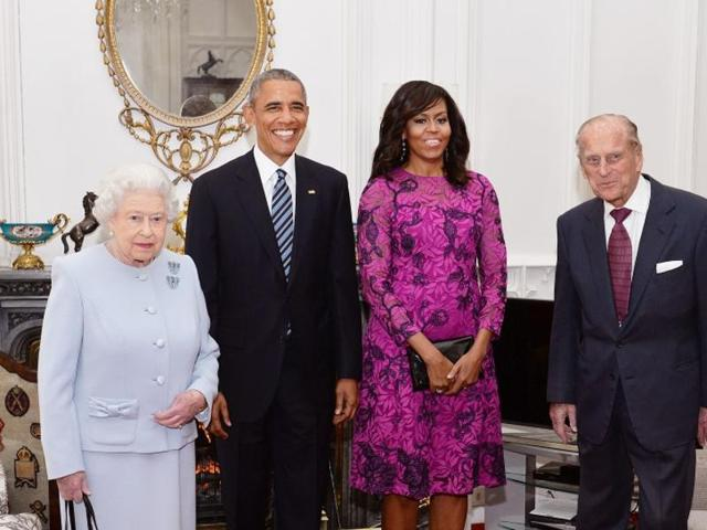 Britain's Queen Elizabeth II and the Duke of Edinburgh stand with the President and First Lady of the United States Barack Obama and his wife Michelle (both centre), in the Oak Room at Windsor Castle ahead of a private lunch hosted by the Queen in Windsor.