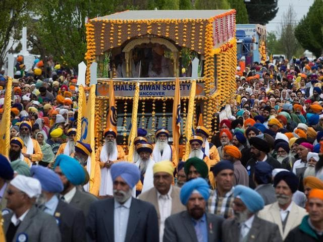 Thousands of people march together during the annual Baisakhi parade in Vancouver recently.