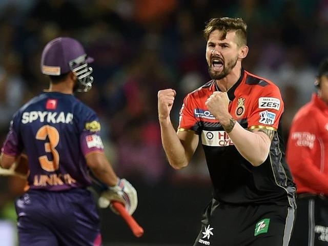 Royal Challengers Bangalore bowler Kane Richardson (C) celebrates after taking the wicket.