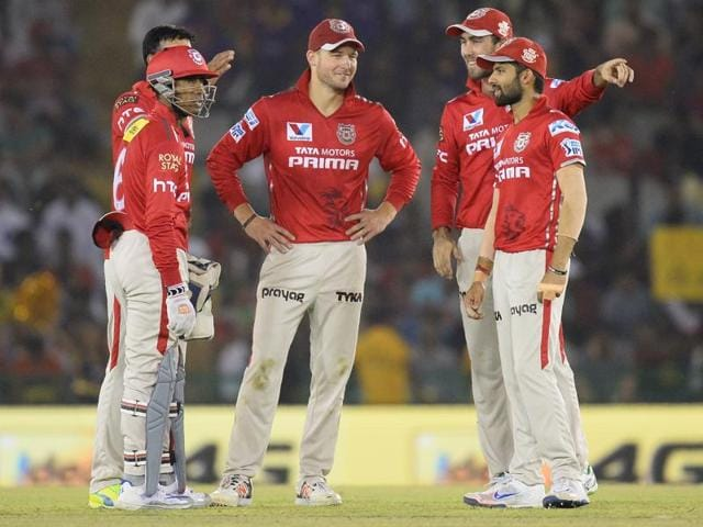Kings XI Punjab captain David Miller (C) celebrates with his players the wicket of KKR batsman Robin Uthappa.