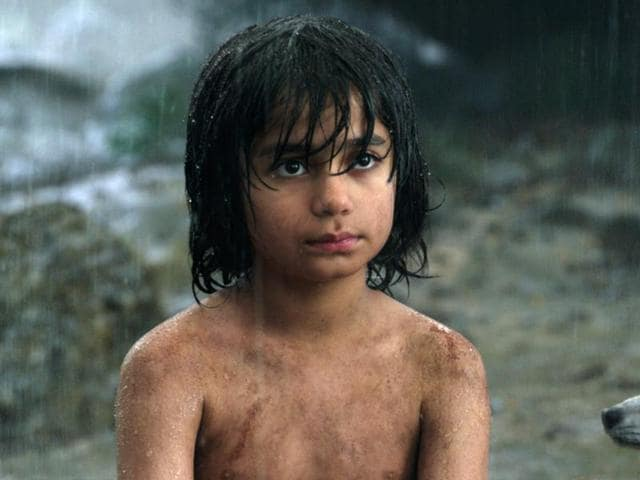 Mowgli, portrayed by Neel Sethi, right, and Baloo the bear, voiced by Bill Murray, in a scene from