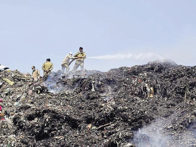 A firefighter tried to douse the flames at the Bhalswa landfill in New Delhi.