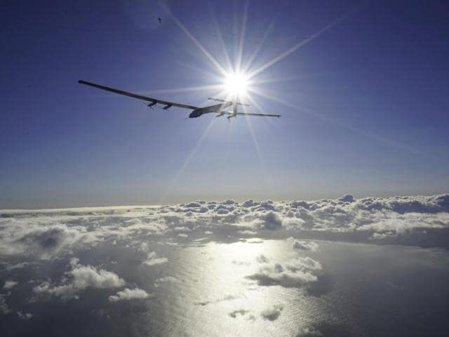 Solar Impulse 2, piloted by Bertrand Piccard, rises from the tarmac at Kalaeloa Airport at it resumes its around-the-world flight, in Hawaii.