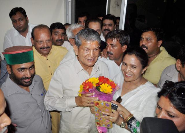 Chief Minister Harish Rawat meets Governor KK Paul in Dehradun on Thursday after the Uttarakhand High Court quashed the imposition of President' rule in the state.