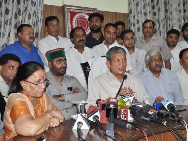 Deposed Chief Minister Harish Rawat addresses the media in Dehradun on Thursday after Uttarakhand High Court quashed the imposition of President's rule in the state and revived the Congress government.