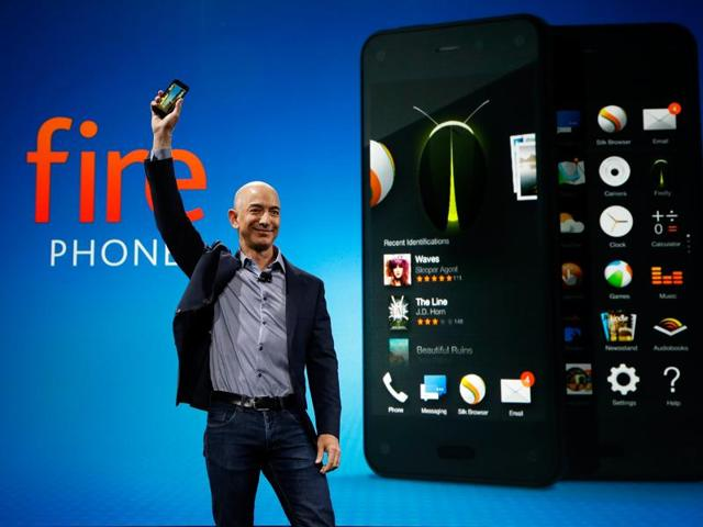 Amazon CEO Jeff Bezos holds up the new Amazon Fire Phone at a launch event in Seattle