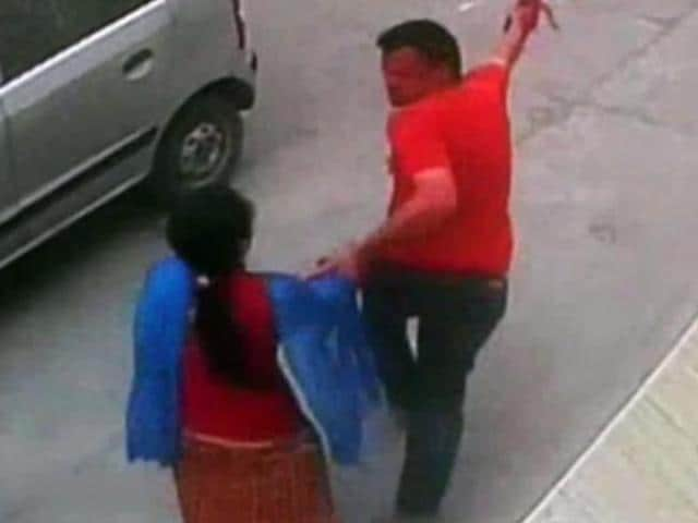 A CCTVgrab of the victim being dragged out of her office by the accused inMuktsar.
