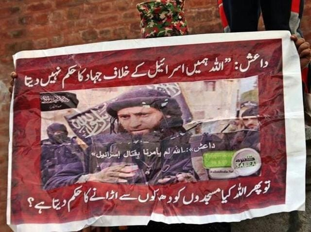 "Written in Urdu, the poster shows an IS commander as saying, ""God does not order us to declare jihad against Israel"", in response to which a second line questions: ""Then does God order you to blast mosques?"""