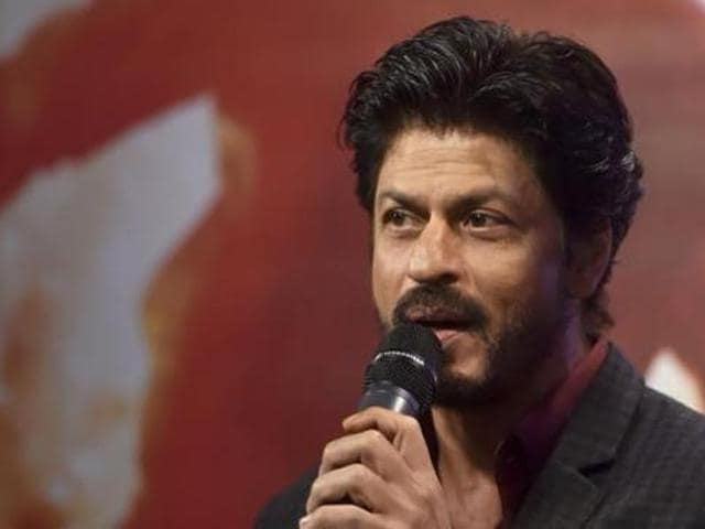 Shah Rukh Khan speaks during a news conference at Madame Tussauds in London.