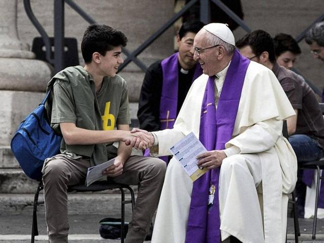 Pope Francis shakes hands with a young faithful after confessing him during Youth Jubilee at Saint Peter square in Vatican on Saturday.
