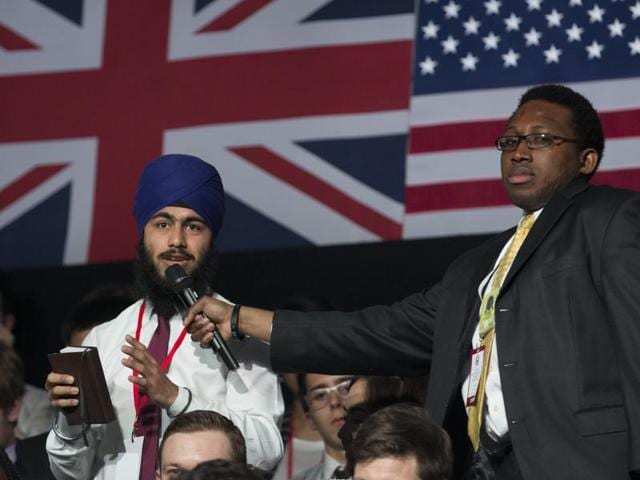 A Sikh man asks a question of US President Barack Obama during a town hall meeting with an audience at Lindley Hall, the Royal Horticultural Society, in London.