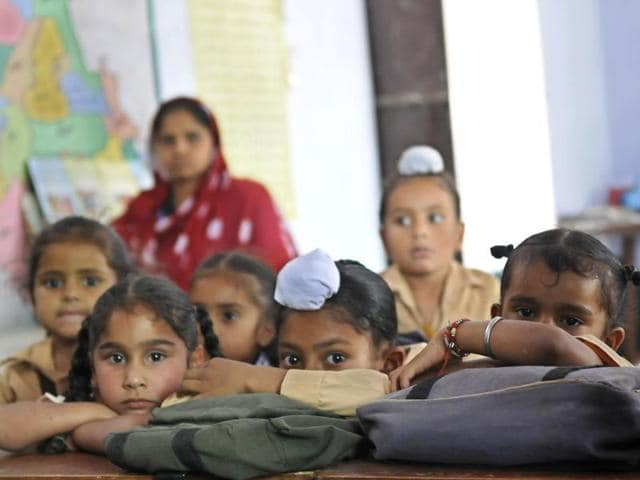 Tiny tots waiting for teachers at Baihara Primary School in Rupnagar district.