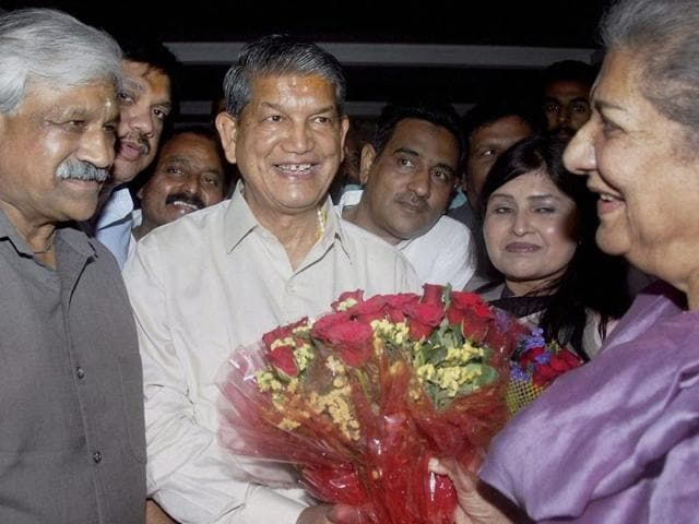 Uttarakhand Congress incharge Ambika Soni (R) presents a bouquet to Chief Minister Harish Rawat during a meeting in Dehradun on Friday, April 22, 2016.