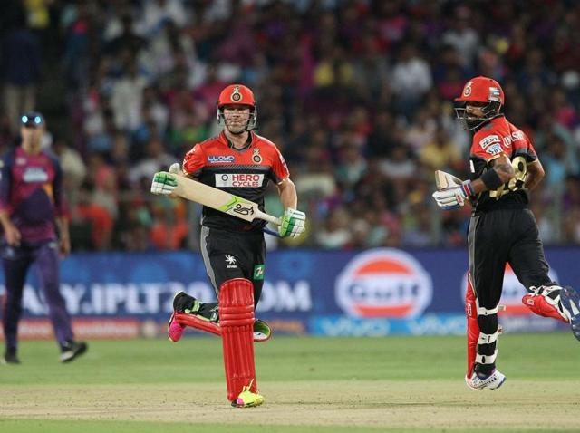 AB de Villiers and Virat Kohli in action against Rising Pune Supergiants during their IPL match at the MCAStadium in Pune on Friday.