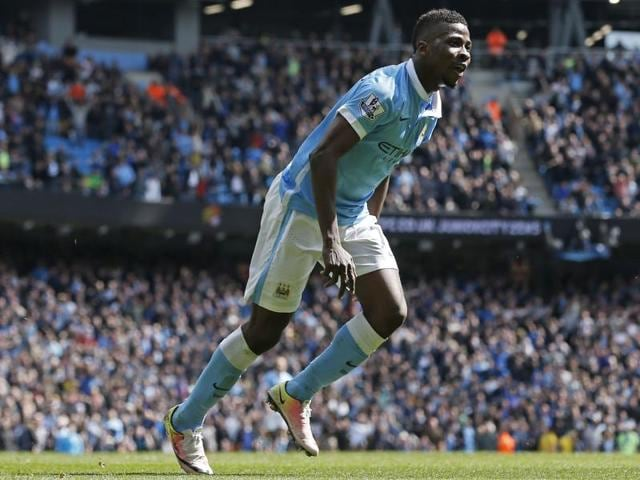 Kelechi Iheanacho rounds Stoke's Jakob Haugaard to score the fourth goal for Manchester City.