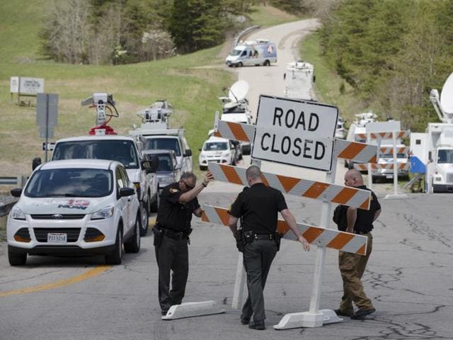 Authorities set up road blocks at the intersection of Union Hill Road and Route 32 at the perimeter of a crime scene, Friday, April 22, 2016, in Pike County, Ohio.