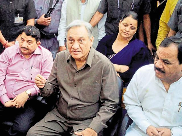 Rebel Congress leader Vijay Bahuguna with supporters at his residence in Dehradun.