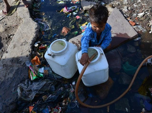 Rachna Nagar residents wait for water supply in Bhopal on Sunday.
