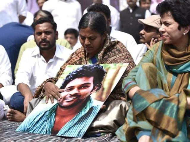 Radhika Vemula, mother of Rohith Vemula, holds a sit-in at Jantar Mantar in Delhi to protest his suicide in this March 2016 photo. She is pictured holding Rohith's photo.
