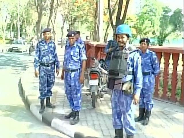 Security personnel posted at the Aligarh Muslim University after violence erupted early on Sunday.