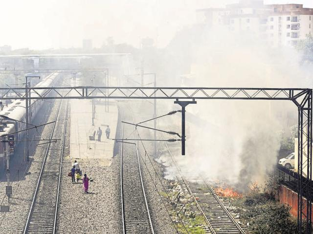 Garbage being burnt at Minto Road Railway Station in New Delhi on Saturday.