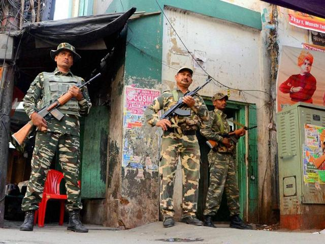 Securitymen keep strict vigil in front of a polling station in Howrah on the eve of the fourth phase of West Bengal assembly elections.