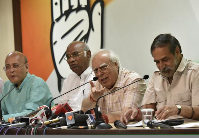 Congress leaders (L-R) Abhishek Singhvi, Mallikarjun Kharge, Kapil Sibal and Anand Sharma address media persons at the party headquarters in New Delhi. (Photo by Ravi Choudhary/ Hindustan Times)