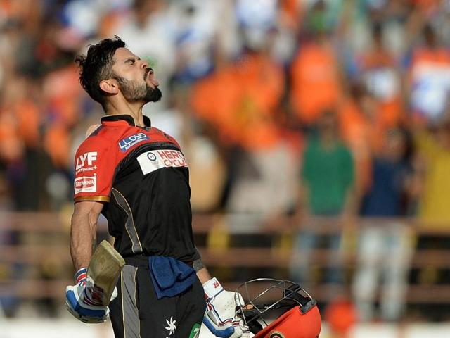 Virat Kohli celebrates his maiden T20 hundred.