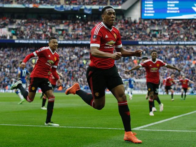 Manchester United's French striker Anthony Martial (C) celebrates after scoring their second goal.