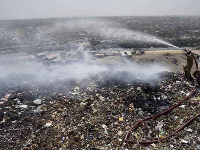 Experts say that the trash piled in dump yards degenerates into highly combustible methane gas.