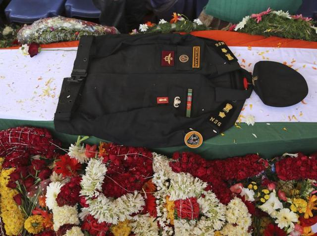 The uniform of India's National Security Guard commando Niranjan Kumar, who was among those killed in the attack on the Pathankot air force base is placed on his coffin draped in an Indian flag, in Bangalore, India.