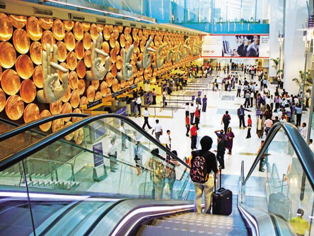 Passengers arrive in the integrated Terminal 3 of the IGI Airport.