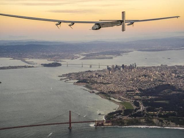 Solar Impulse 2, piloted by Bertrand Piccard of Switzerland, flies over the Golden Gate bridge in San Francisco, California.