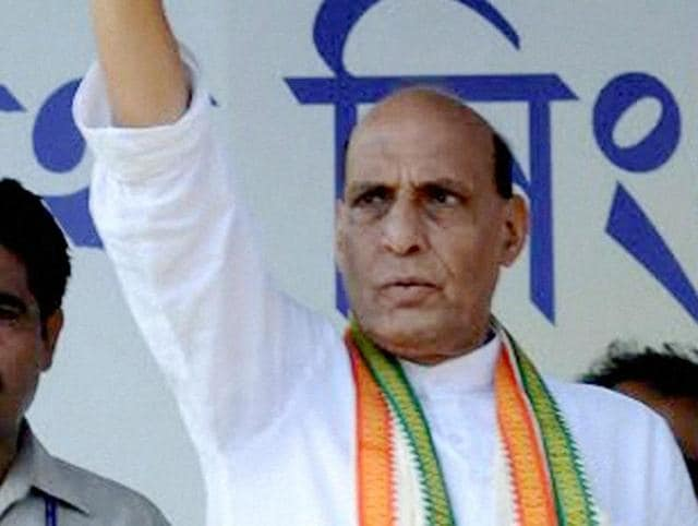 Union home minister Rajnath Singh greets people during an election campaign at Gaighata in North 24 Pargana district.