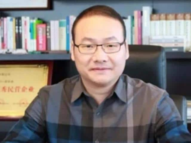 Yang Weiguo, allegedly on the run with $150 million of investors' money from a city in eastern China, appeared in an online video on Monday.