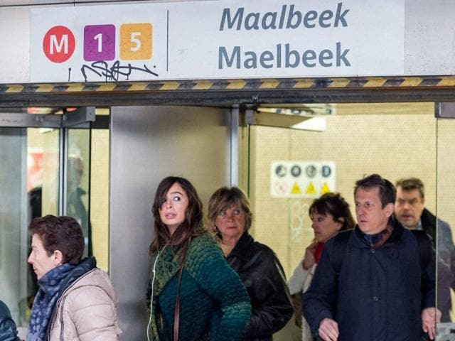 Commuters leave Maelbeek metro station in Brussels on Monday April 25, 2016.