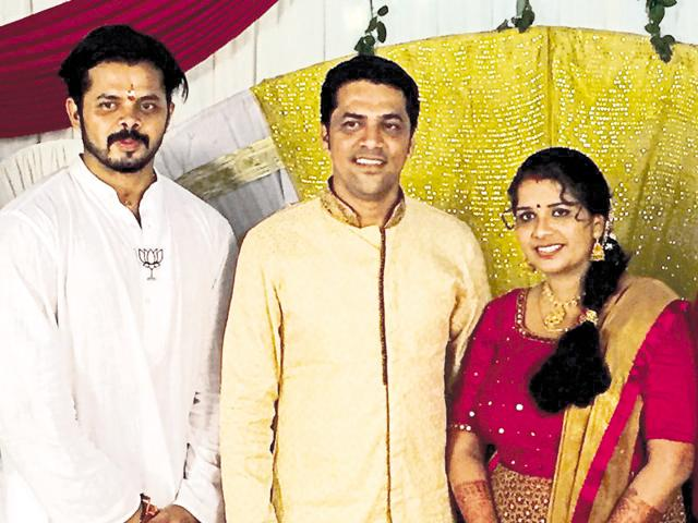 BJP's Thiruvananthapuram central candidate, S Sreesanth, with a newly-wed couple.