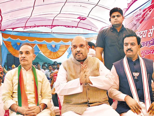 BJP leaders including party president Amit Shah (centre) were speaking at a meeting held under the Centre's 'Gram Uday se Bharat Uday' programme at Chirori village in Loni.