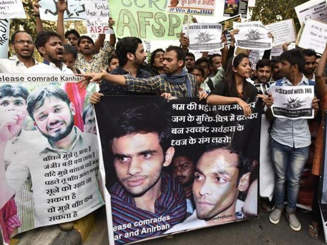 Demonstrators shout slogans as they hold placards of Kanhaiya Kumar, Umar Khalid and Anirban Bhattacharya who are facing charges of sedition, in New Delhi.